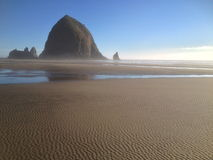 Ripples in sand at Canon Beach, Oregon. Ripples in sand at low tide at haystack rock Royalty Free Stock Images