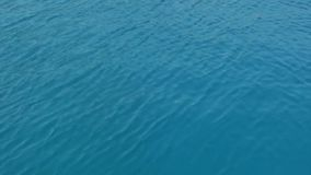 Ripples on the sea surface stock footage