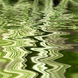 Rippling green reflections Stock Photography