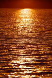 Rippling water. Reflection of sun setting over body of water - ripples stock photo