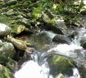 Rippling water. Hiking along beautiful rippling waters, within the rocks stock photos