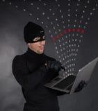 Riprogrammatore che ruba i dati Fotografia Stock Libera da Diritti