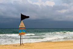 Riptide Warning. The black flag is raised in warning of rough seas, undertows and riptides stock photo