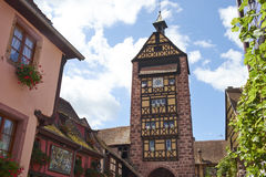 Riquewihr France. Riquewihr beautiful traditional village of Alsace in France, clock tower and typical houses Royalty Free Stock Photography