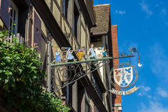 RIQUEWIHR, FRANCE/ EUROPE - SEPTEMBER 24: Hanging sign in Riquewihr in Haut-Rhin Alsace France on September 24, 2015 royalty free stock images