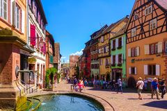 Riquewihr, France-June 23, 2016: Tourists are walking on the main shopping street in Riquewihr. Riquewihr, France-June 23, 2016: Tourists are walking on the main Stock Image