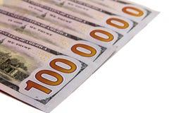 Riqueza e conta de dinheiro O número um milhão de é apresentado de cinco cem notas de dólar em um fundo branco Isolado Close-up Fotos de Stock Royalty Free