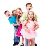 Rir crianças com palhaço cheira estar um perto fotos de stock royalty free