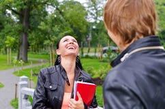 Rire d'étudiant féminin Photographie stock libre de droits