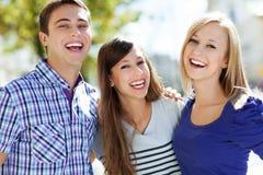 Rire d'amis Photographie stock libre de droits
