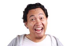Rire d'hommes avec les visages drôles images stock