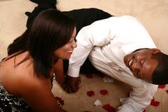 Rire de couples d'Afro-américain Images stock