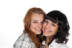 Rire heureux de deux amies de femme Photo stock