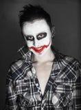 Rire rampant de joker photographie stock