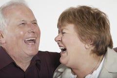 Rire supérieur de couples Image libre de droits