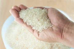 Ris i mänsklig hand Royaltyfri Foto