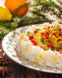 Ris med fisken i orange sås för matställe för jul eller för nytt år Royaltyfria Bilder