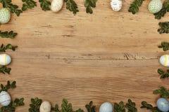 Ris och easter ägg som ram på trä, kopieringsutrymme Fotografering för Bildbyråer
