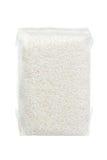 Ris som packas i dammsugen plastpåse Royaltyfri Bild