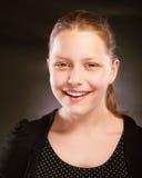 Risa adolescente de la muchacha Imagen de archivo libre de regalías
