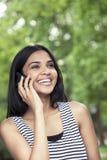Risa adolescente en el teléfono Fotografía de archivo