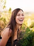 Risa adolescente hermosa de la muchacha Imagen de archivo libre de regalías