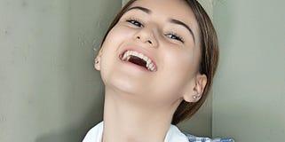 Risa de bastante femenino Fotografía de archivo