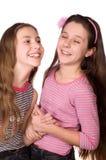 Risa de dos adolescentes aislada en blanco Foto de archivo libre de regalías