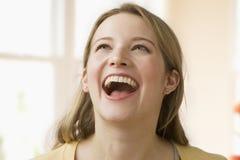 Risa de la mujer joven Imágenes de archivo libres de regalías