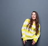 Risa de la mujer joven Imagen de archivo libre de regalías