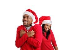 Risa de los pares de la Navidad del afroamericano imágenes de archivo libres de regalías