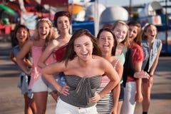 Risa de ocho muchachas Imagen de archivo