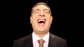 Risa feliz del hombre de negocios almacen de video
