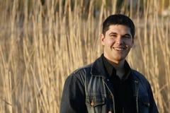Risa hermosa joven del hombre Fotografía de archivo