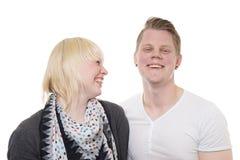 Risa joven de los pares Imagen de archivo libre de regalías