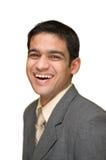 Risa joven del hombre de negocios Foto de archivo libre de regalías