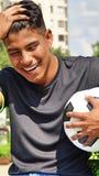 Risa masculina del jugador de fútbol Fotos de archivo libres de regalías