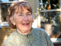 Risa mayor de la mujer Foto de archivo libre de regalías