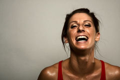 Risa sana de la mujer de la aptitud Fotos de archivo