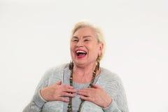 Risata anziana della donna isolata Fotografie Stock