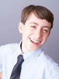 Risata felice dell'allievo della scuola secondaria Fotografie Stock Libere da Diritti