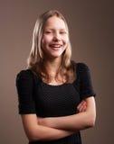 Risata graziosa della ragazza dell'adolescente Fotografia Stock