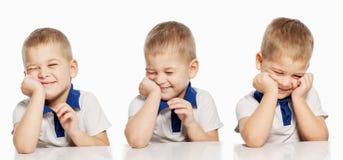 Risate sveglie del ragazzino, isolate su fondo bianco, collage fotografia stock libera da diritti