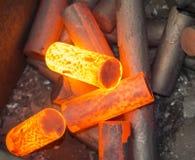 Riscaldamento della billetta per il pezzo fucinato caldo Fotografia Stock