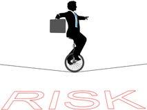 Risco financeiro do tightrope do unicycle do homem de negócio Foto de Stock