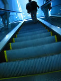 On the rise. A man nearing the top of the escalator Royalty Free Stock Photos