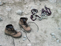 After rise. Pair of boots and pair of crampons Royalty Free Stock Images