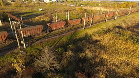 Rise above the drone of a freight train, freight train with a height of drone flights over the freight train.