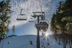 The rise in the chair lift to the top of the mountain. Stock Image