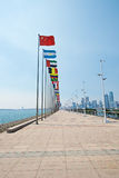Rise of China flag as leader in qingdao Royalty Free Stock Image